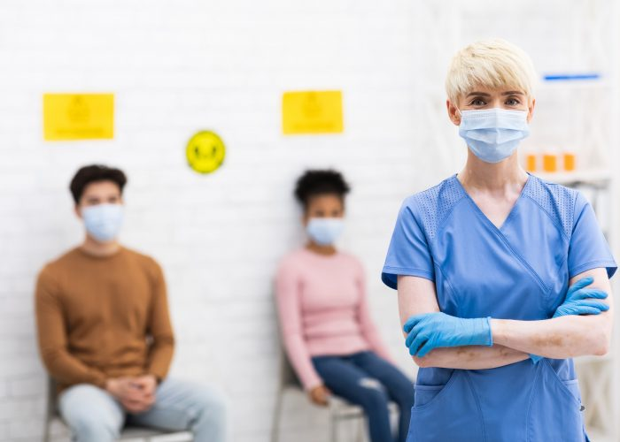 Lady Doctor Standing In Front Of Coronavirus Patients In Hospital